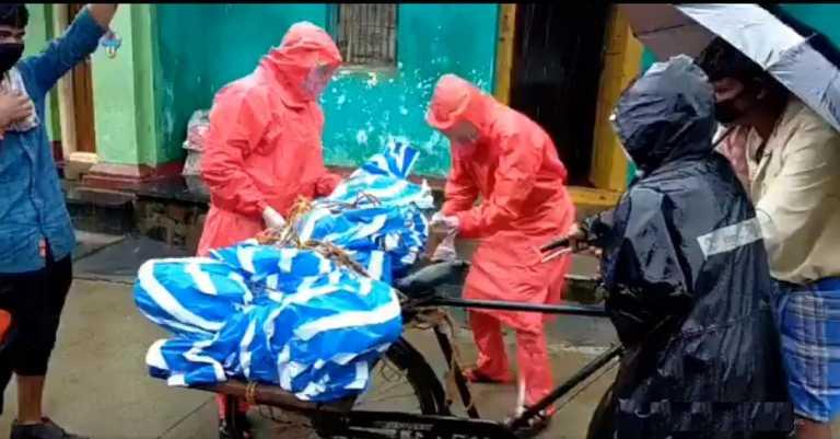 Denied ambulance service, family transports body on bicycle