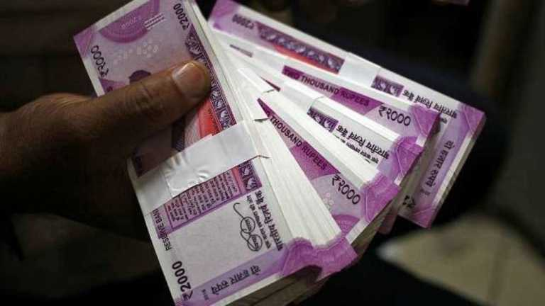 Rupee rises 7 paise to 74.69 against US dollar in early trade